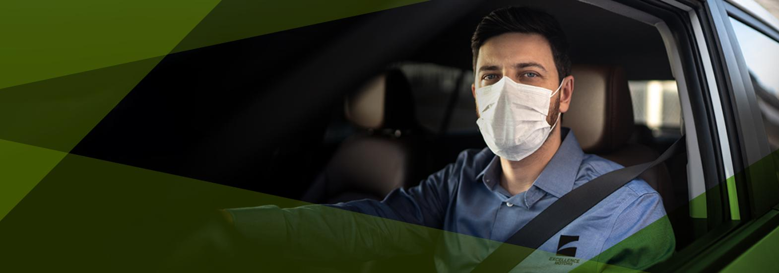 Man in car with mask