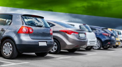 As used cars crowd lots, dealers look for easier ways to mark hard decisions.