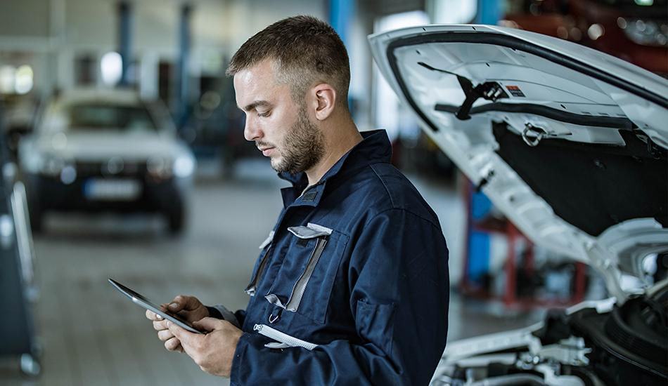 Mechanic looking at tablet